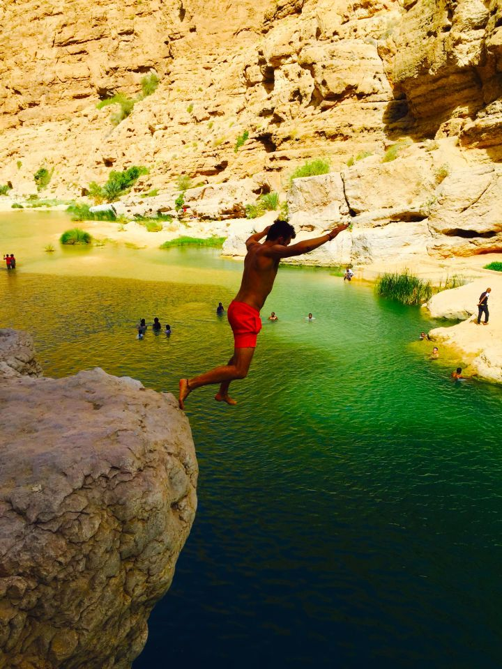 Jumping off a cliff in Wadi Shab Oman